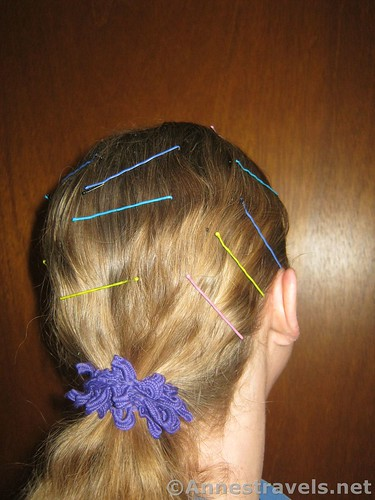 Placing bobby pins along the top of the hair keeps it from flying away in windy environments - 12 Pretty & Practical Hiking Hairstyles