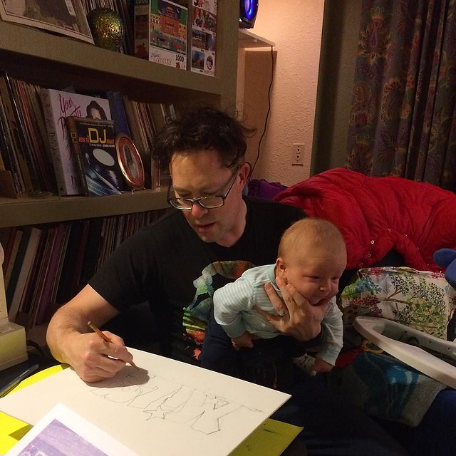 Babies make you better multitaskers--here's Josh drawing and holding his son at the same time. 💕