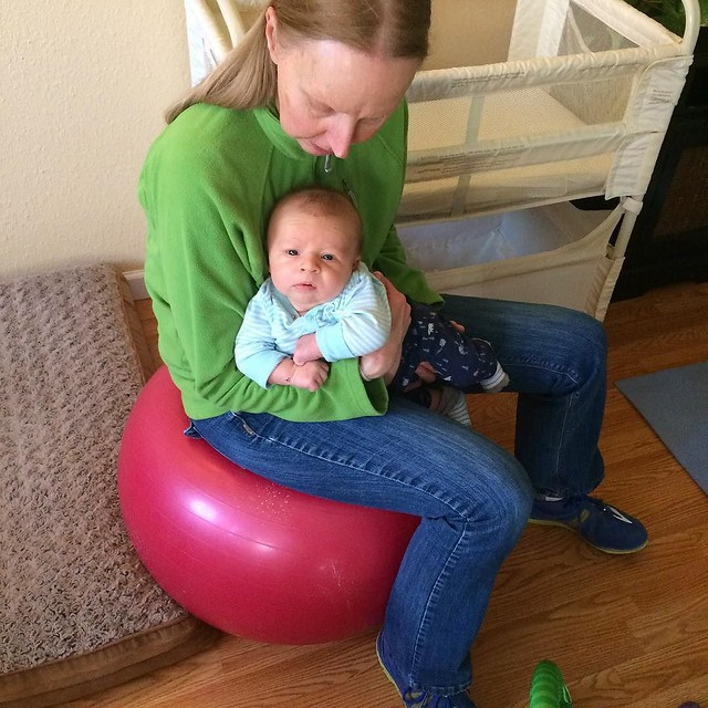 He looooves to bounce on the stability ball.