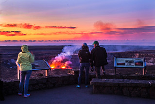 Vistiors watch the glowing lava lake at sunrise | by Hawai'i Volcanoes NPS