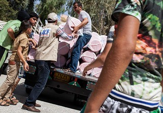 Action Against Hunger team deliver hygiene kits to Iraqi refugees | by DFID - UK Department for International Development