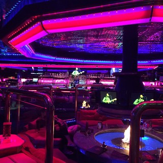 Umm. This is a neon lounge, with a fire pit in 100 degree weather. And sunken red velvet love seats. I cannot overstate just HOW much neon. #vegas | by Shrie Bradford Spangler