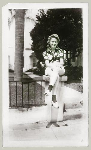 Woman sitting on a post