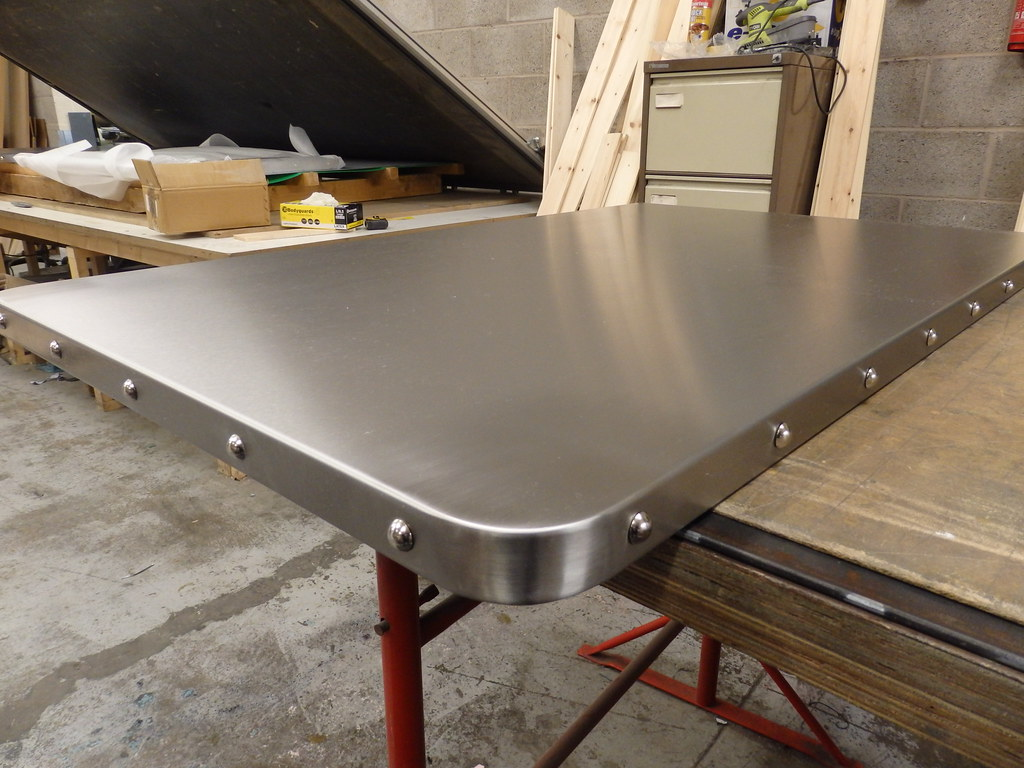 31 satin stainless steel table top with chrome studs by metal sheets limited