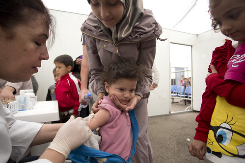 Fatima, a Syrian refugee as her children vaccinated | by World Bank Photo Collection