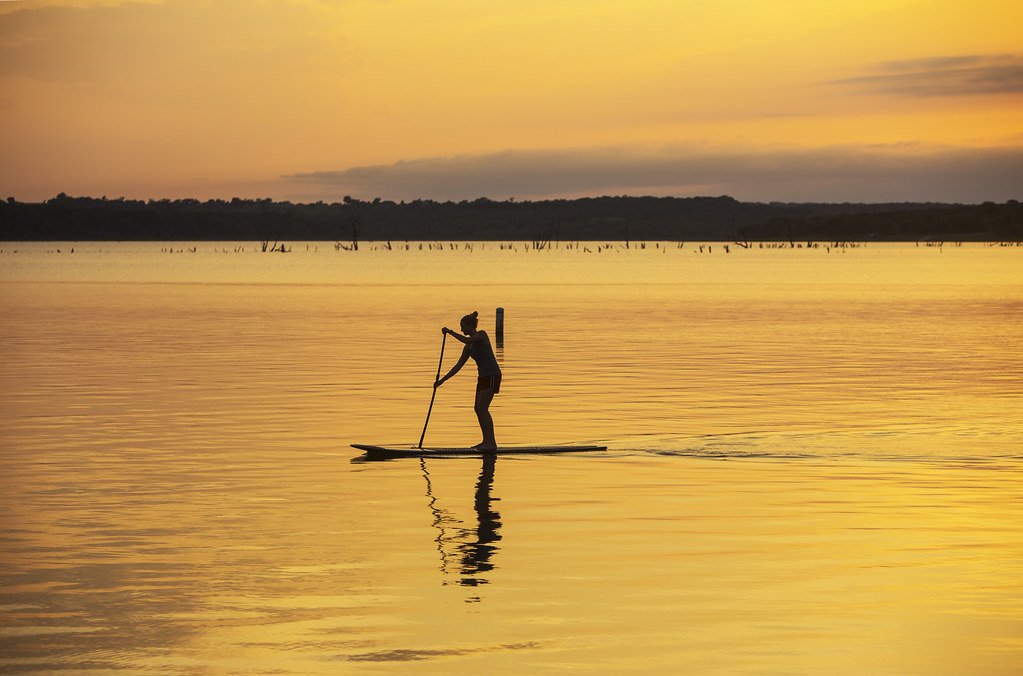 Stand-up paddleboarding at sunset