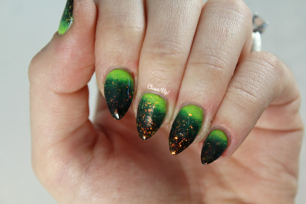Green and black gradient nail art