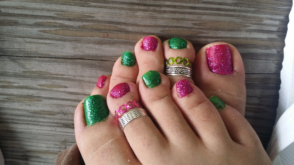 Green and purple toes with a coat of sparkles on top. Tell… | Flickr