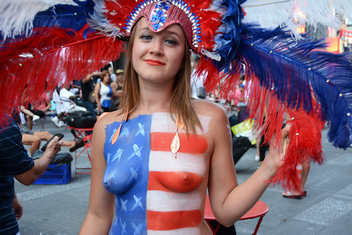 women in times square in nyc wearing only body paint phot