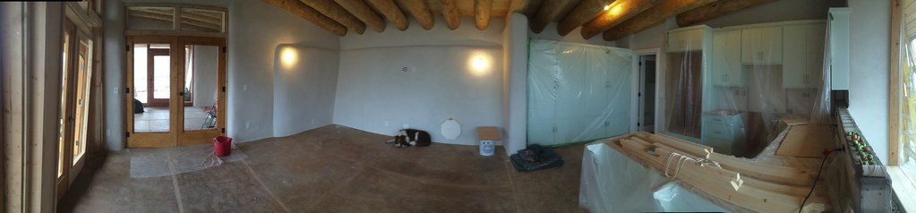 By Green Energy A Panorama Of The Nearly Completed Earthship Living Room And Kitchen
