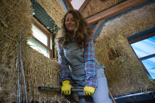 Tara Stretching Wire Mesh Over Straw Bale | by goingslowly