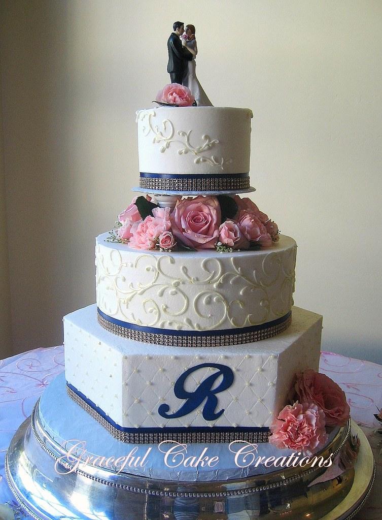 Elegant Ivory Wedding Cake with Navy Blue and Champagne Ri… | Flickr