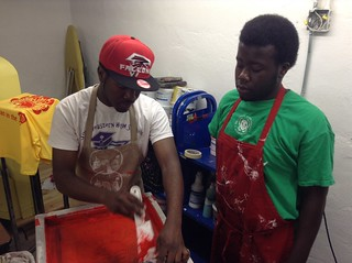 Jeremiah and Eli'shah working together in screen printing room. | by Mt Elliott Makerspace