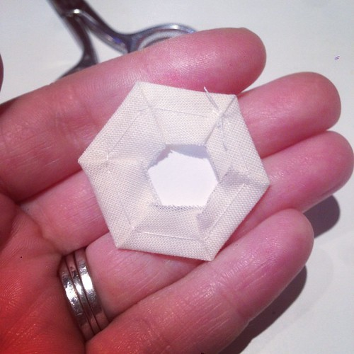 (The back of a hexagon basted around, not through, the paper.) | by Penny Poppleton
