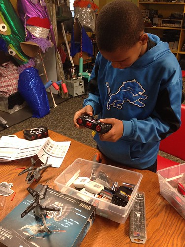 Tyree trying to make one working r/c helicopter out of two broken ones. | by Mt Elliott Makerspace