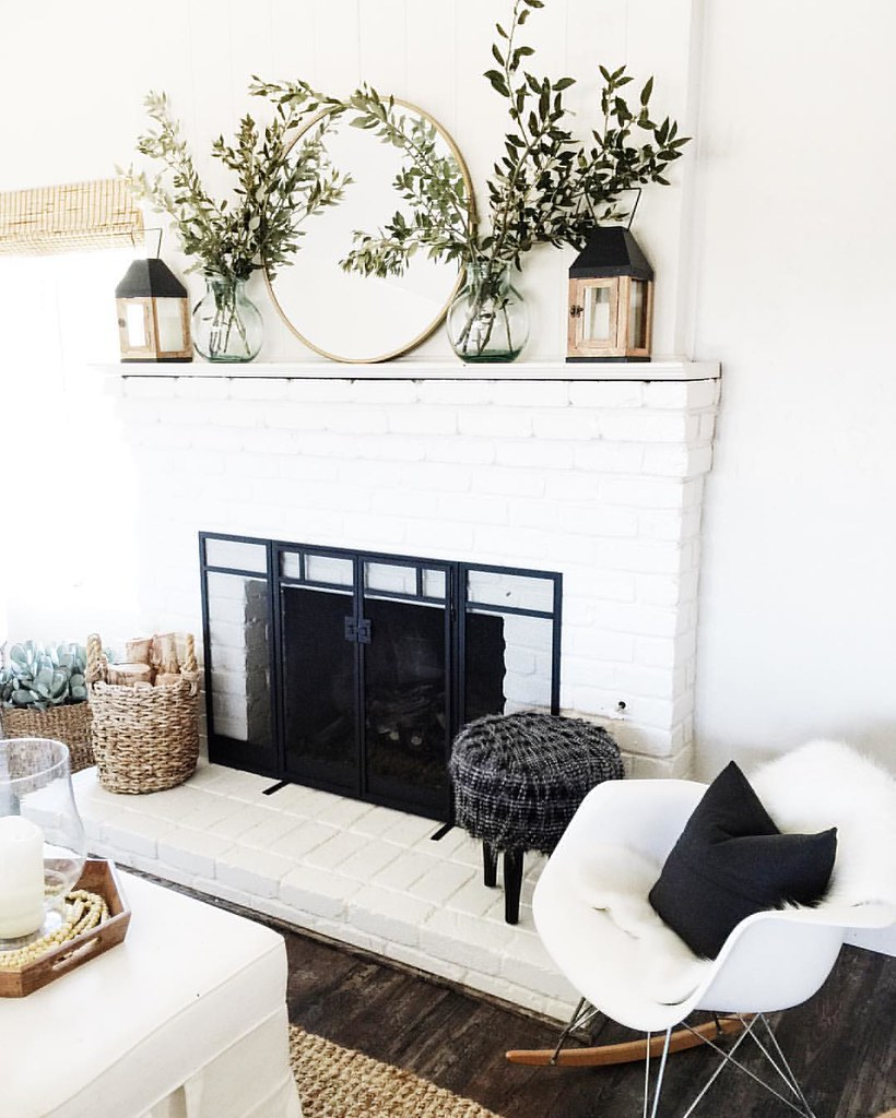Minimal Living Room Decor Inspiration | Circular mirror on mantle with greenery