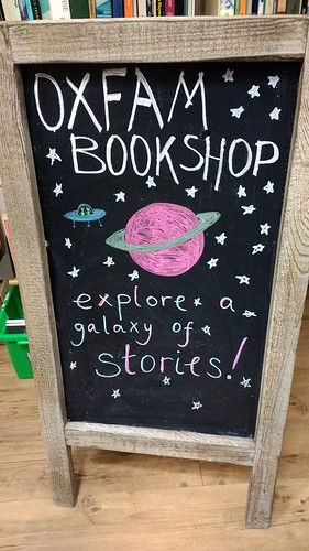 chalkboard illustration of a planet, stars and alien spaceship - explore a galaxy of stories