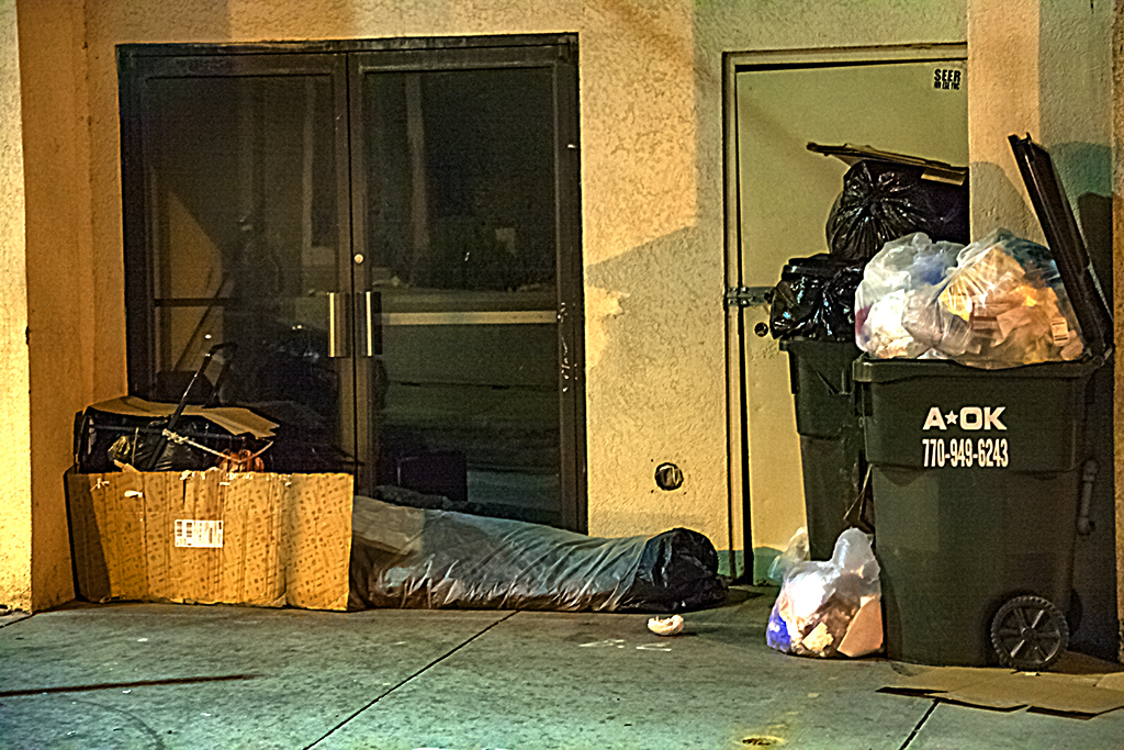 Sleeping homeless person and two trash cans--Atlanta