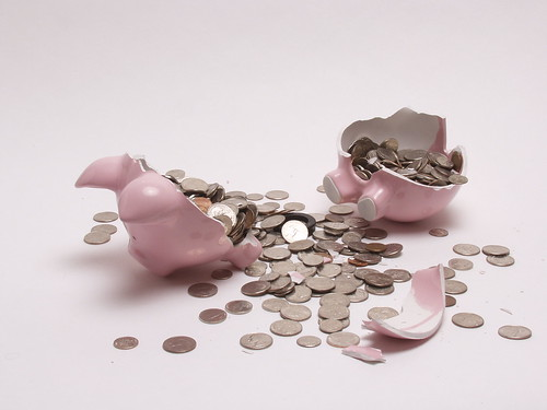 Smashed Piggy Bank with Coins