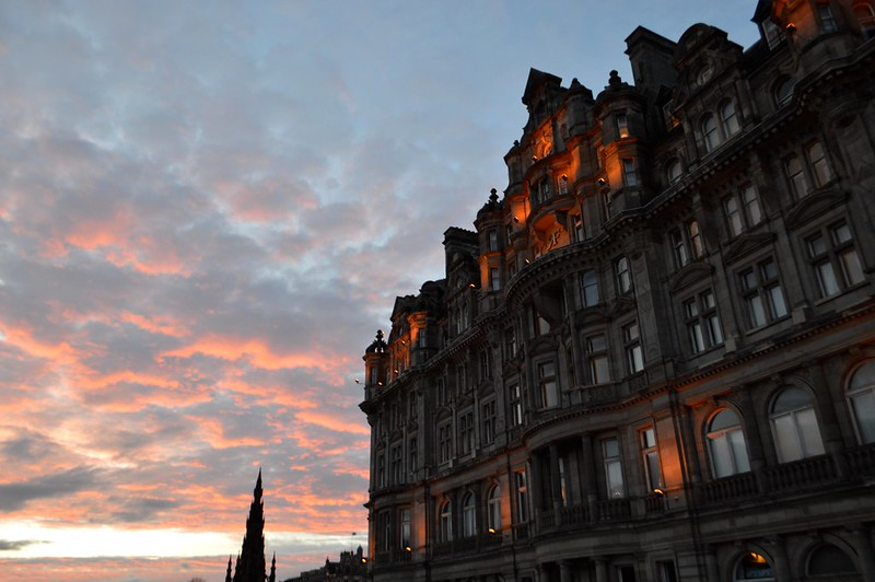 This is a picture of a sunset over buildings in edinburgh