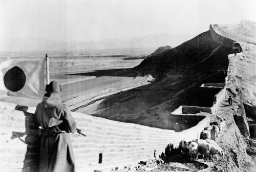 Japanese soldier looking over a section of the great wall of China during the Second Sino-Japanese War, 1937.
