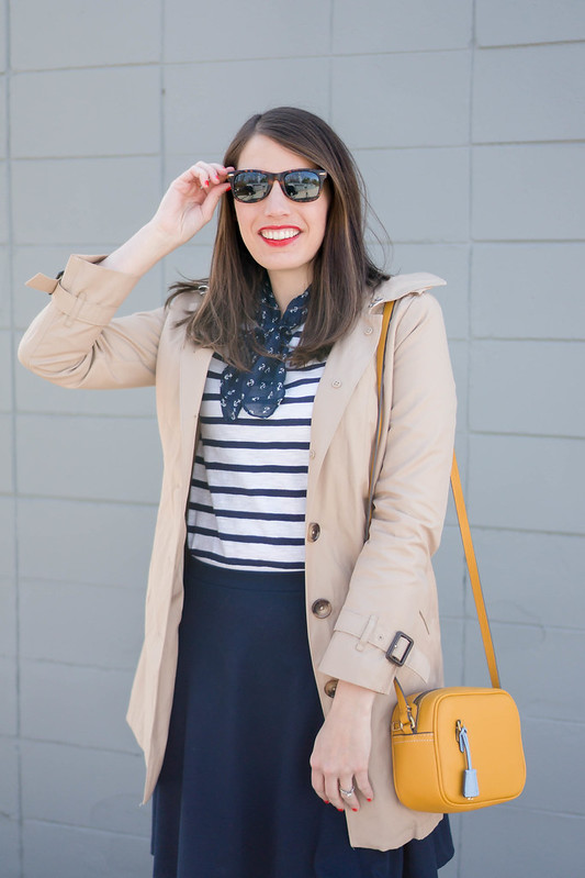 navy skirt + navy and white stripe tee + trench coat + anchor print scarf + yellow crossbody purse; spring work outfit; nautical look | Style On Target blog