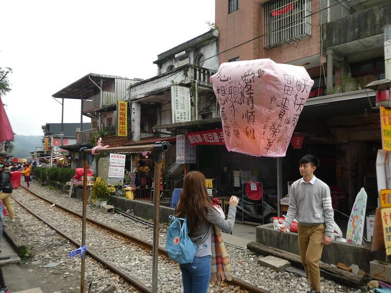 Launching a paper lantern into the air in Shifen, Taiwan