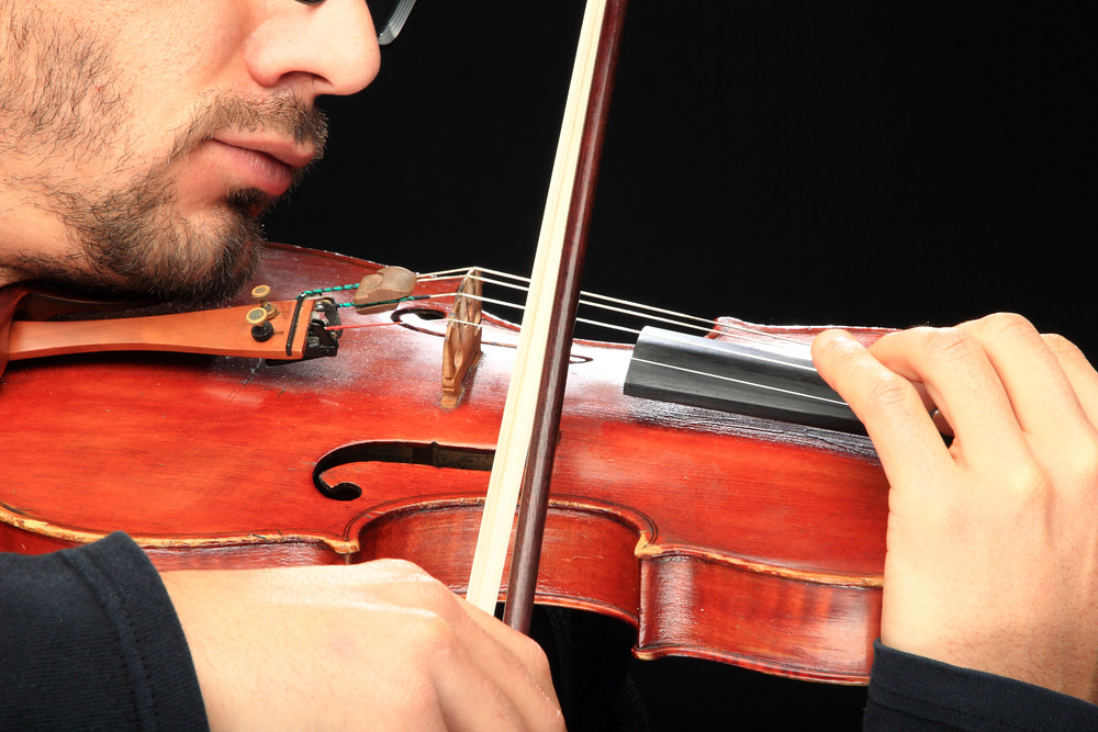 Close-up of violinist playing