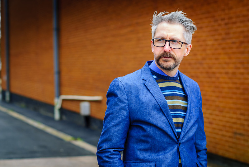 Smart menswear: Blue blazer \ striped sweater \ grey dress trousers \ brown brogues | Silver Londoner, over 40 style