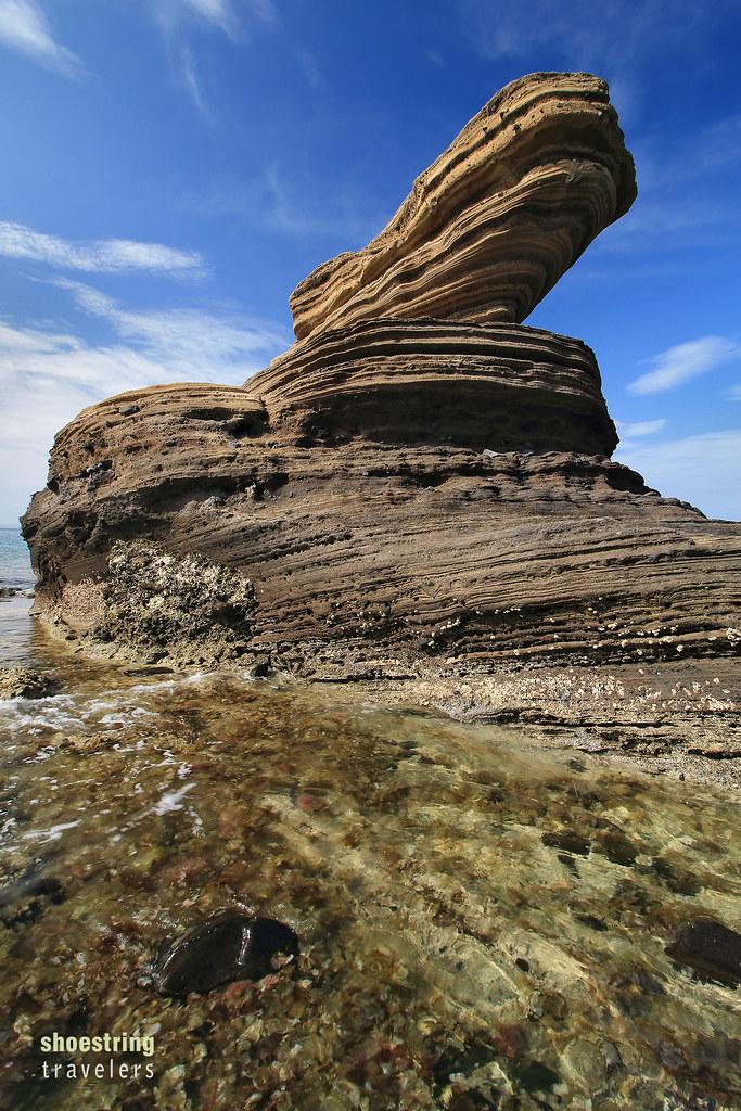 naturally sculptured rock resembling a dinosaur head at Animasola Island