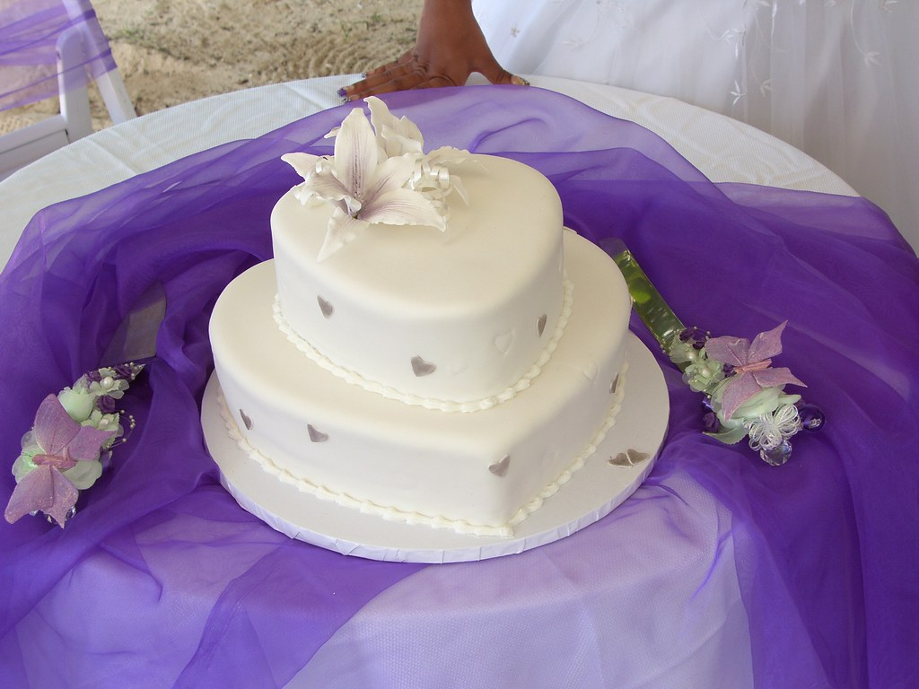 Heart shaped white two tier wedding cake at beach wedding | Flickr