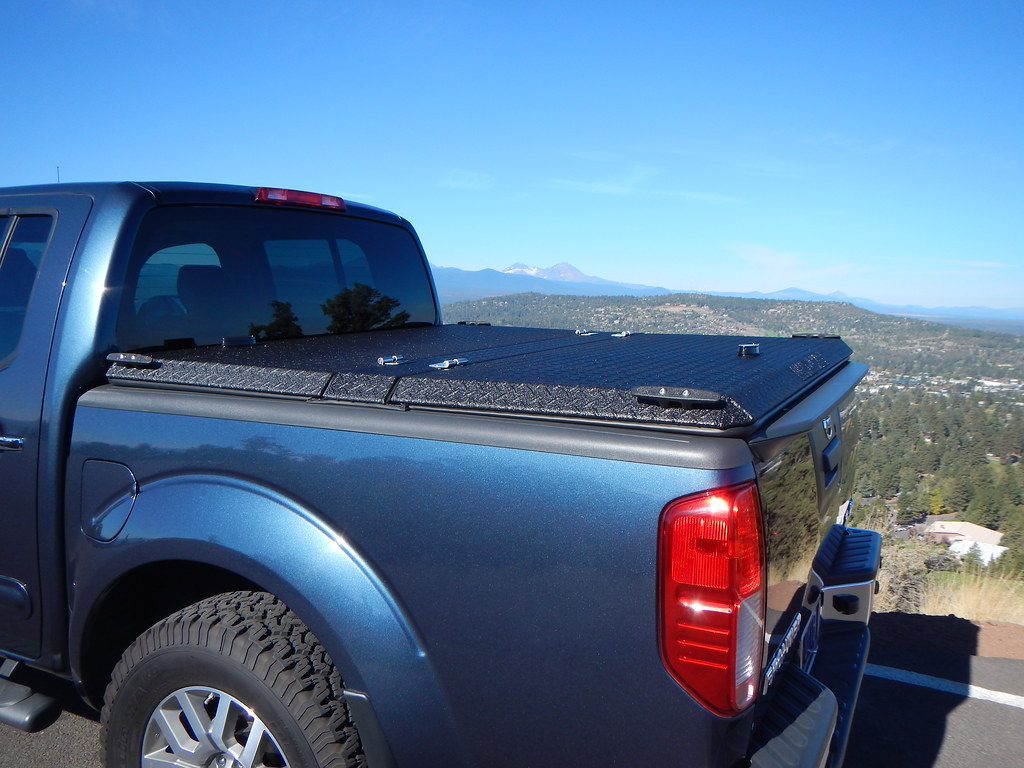 ... Black Truck Bed Cover On Blue Nissan Frontier | By DiamondBack Truck  Covers