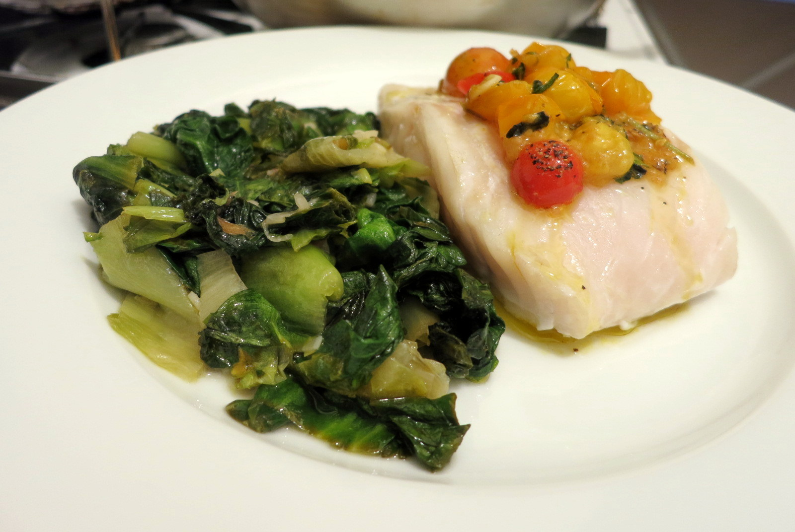 Roast cod, skillet escarole, heirloom tomatoes