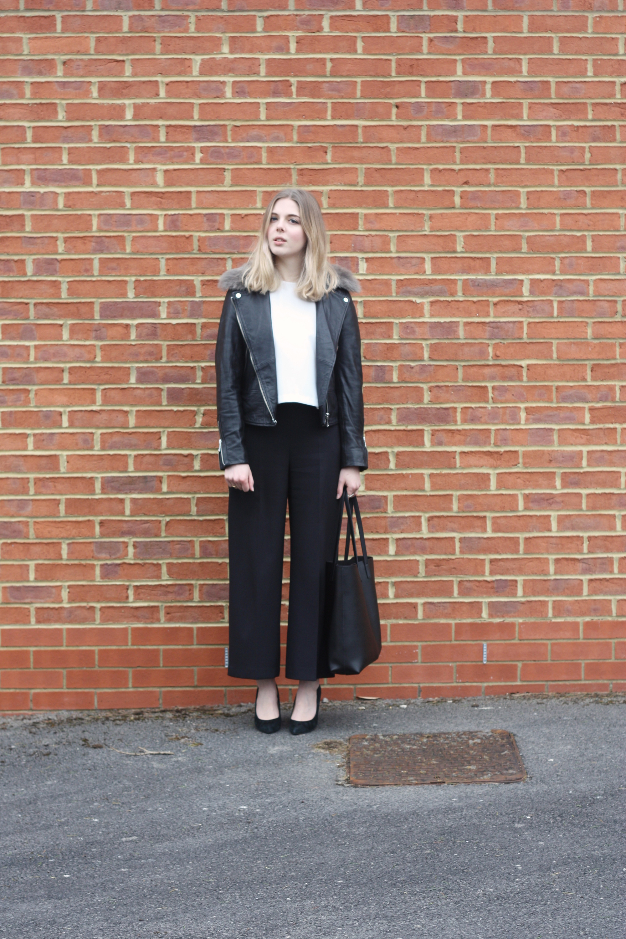 Whistles black suede heels, Zara cream fluted sleeve top and Saint Laurent tote bag