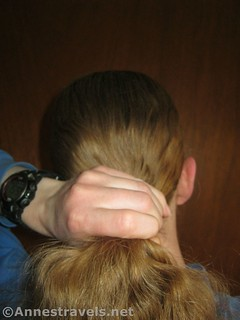 Comb the hair back and grasp with one hand when making a ponytail - 12 pretty & practical hiking hairstyles