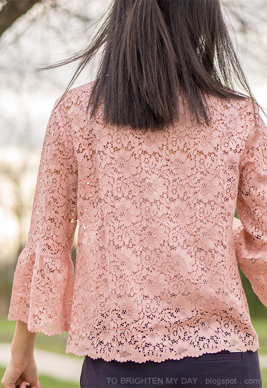 pink lace top with bell sleeves, navy ankle pants