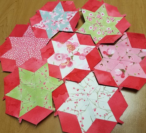 Seven sisters. I think these need another rounds, so I cut out and basted more blocks today. #sakurafabric #hexies #Englishpaperpiecing