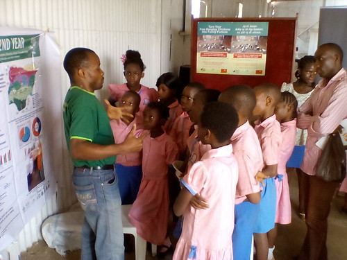 ACGG Nigeria staff answering primary school children