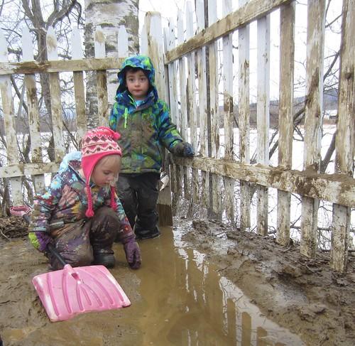 scooping up mud