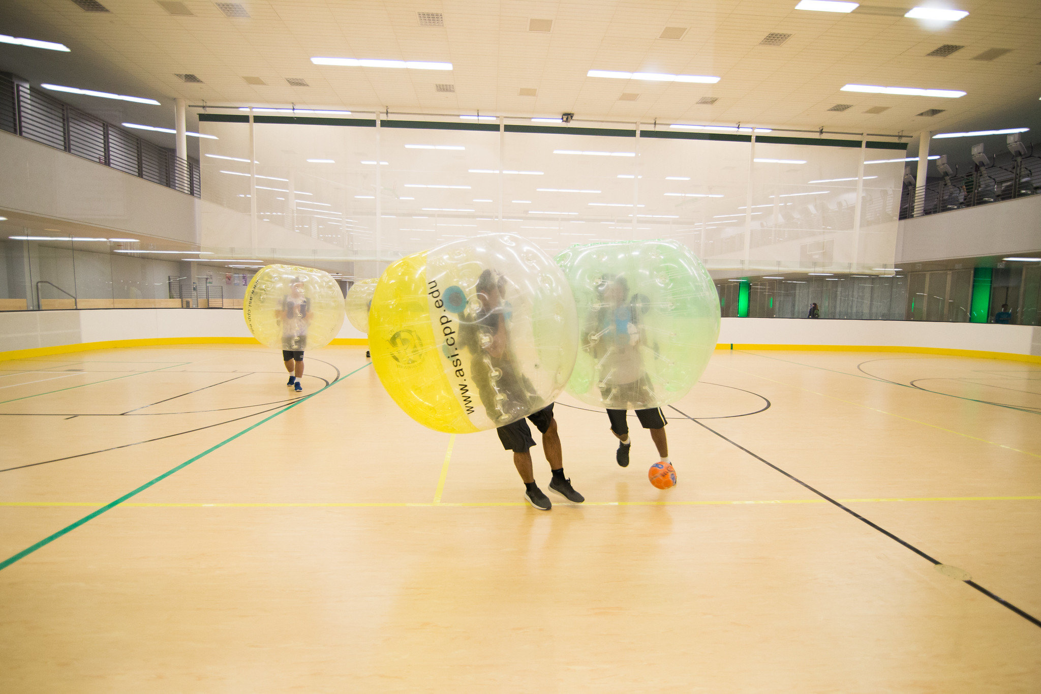 people playing bubble soccer
