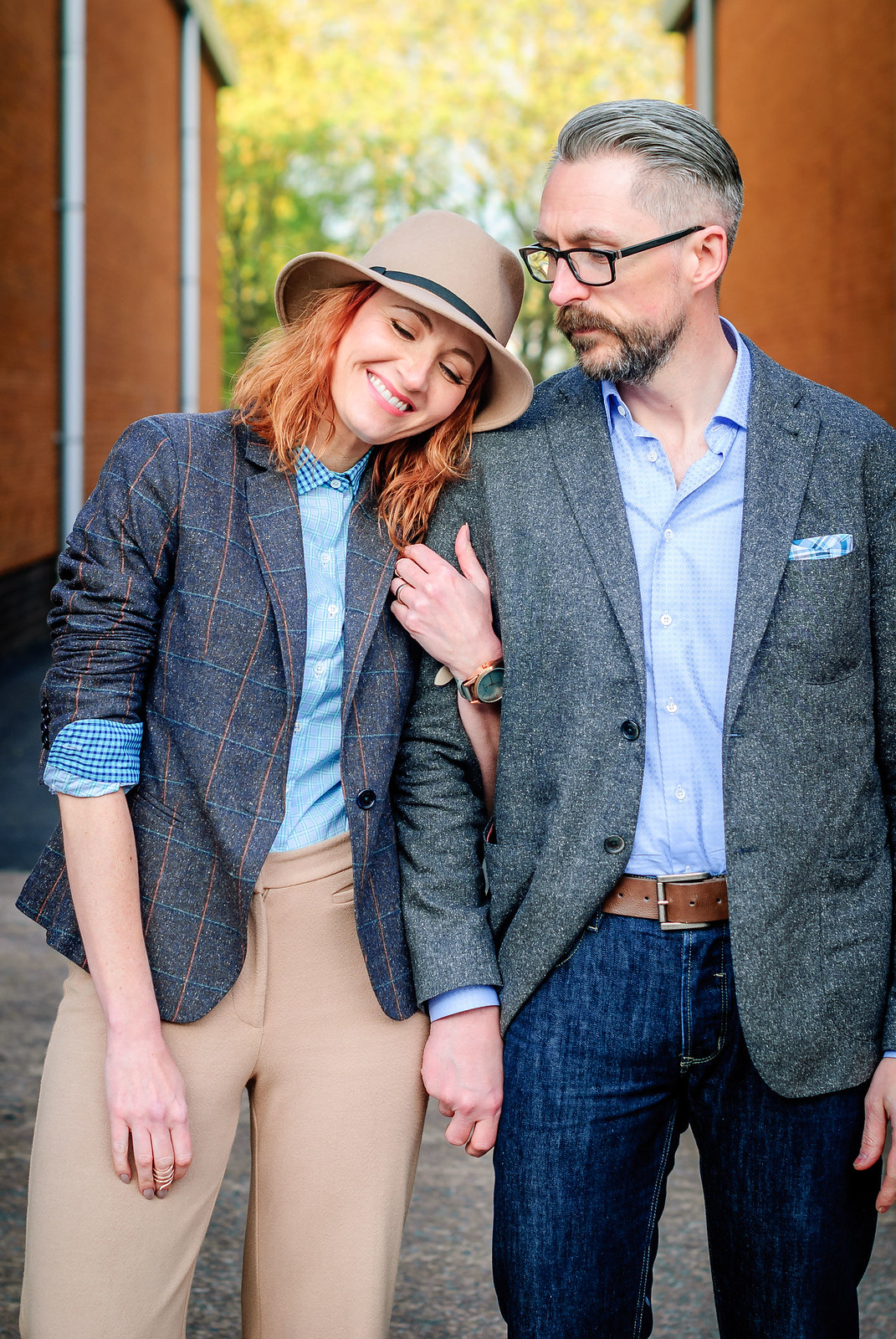 Smart British tailoring by Arthur Shirtley. Her: Check shirt \ tweed silk blazer \ camel wide leg trousers \ silver slip on sneakers \ camel fedora - Him: Dark wash jeans | Not Dressed As Lamb & Silver Londoner, over 40 style/menswear