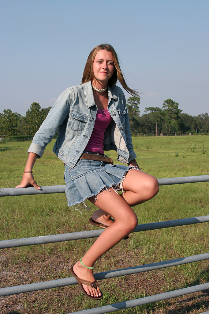 Country Girl On Fence  A Beautiful Farm Girl Sitting On A -5340