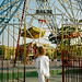 Child waits for her turn on a ferris wheel