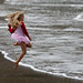 From 32 Cute Little Girl in Pink Dances on Beach photos set (uncropped) keeper