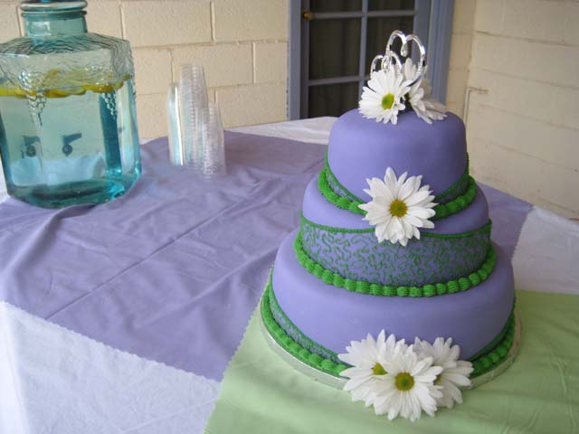 White Fondant Cake With Purple Accent Flowers Wedding