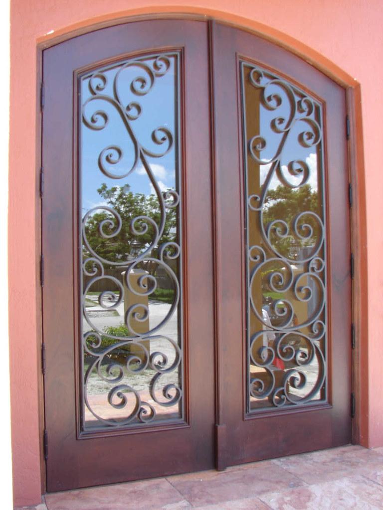 Custom wrought iron wood door whetchester model more for Wood doors with wrought iron