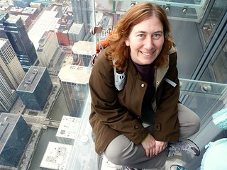 me  on a skydeck ledge | by The Shifted Librarian