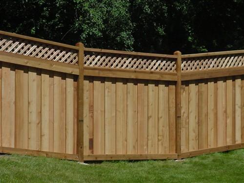Western red cedar board over lattice top fence