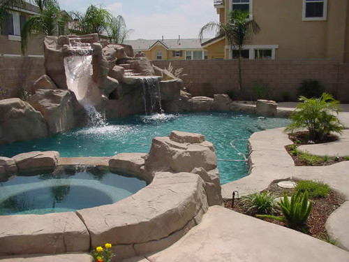 Custom rock swimming pool design rock water slide and for Custom indoor pools