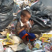 Playing at the rubbish dump.
